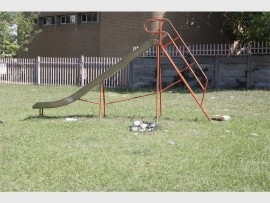 Park equipment is surrounded by filth.