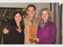 Coach, Grace Filipe and Elize van der Merwe flank Ruan Janse van Vuuren, rewarded for putting in the most training hours.