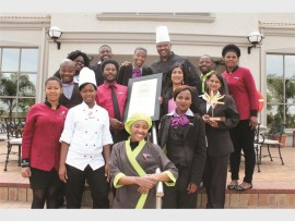 The staff at Garden Court Hotel stand proud with their national award.