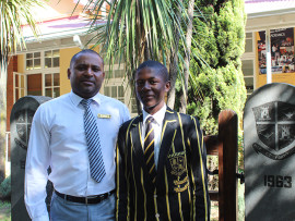 Newcastle High School Principal, Manuel Govender, with Sithembiso Thusi.