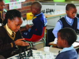 Learners are taught to play chess.