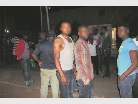 An angry mob of more than 40 foreign nationals marched to the police station.