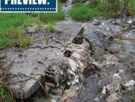 overflowing manhole