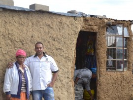 The grandmother of six-year-old Lindokuhle Khoza, who's funeral was paid for by Preshu Singh and other businessmen. Preshu, (right) and his friends will soon start on the foundations of a new house for the family.