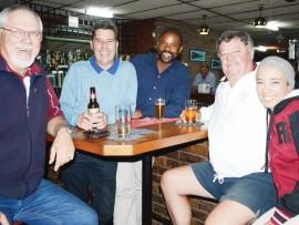 Willie Nel, Scott Yardley, Thokozani Mhize, Dirk Wessels and Welda Pillay enjoying the social side of bowls.