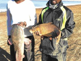 Malcolm Govender with his 9.4kg barbel and Vernen Naicker with his 3.3kg carp.