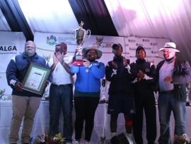 UThukela District Deputy Mayor Cllr NW Sibiya lifting up the trophy won by men's soccer team (Medium)