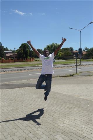 An ecstatic Simphiwe takes a big jump into his future.
