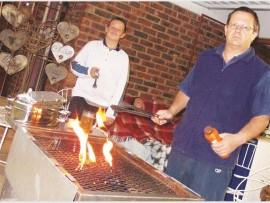 Peter Mossop prepares to make the magic around the braai happen, with his son, Jason.