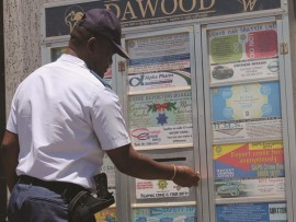 The SAPS's Major Mbatha opens one of the crime-report boxes to check for letters.