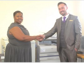Harpo's principal Mrs Malibongwe Masombuka and SA Office Solution's Andre Coetzer.
