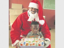 Each child got a chance to sit on santa's lap with their gift.