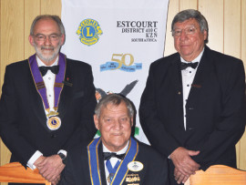 Incoming Estcourt  Lions Club President, Patrick Louw, District Lions Club  President, Willie vd Schyff and Outgoing Estcourt  Lions Club President, Cecil Friend.