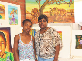 Bongiwe Mngadi with her aunt, Nondumiso Hazel Mngadi, in front of her artworks.