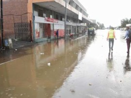 A section of the street and pavement in Alfred Street is flooded after last Thursday's storm.