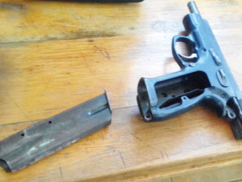 The unlicensed 9mm pistol recovered from two suspects.