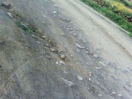 A section of a road in Weenen, which a resident says is damaging vehicles and requires urgent repairs.