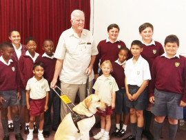 Mr Giles and Nixon with a group of St Gregory learners.