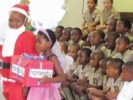 Father Christmas, Lwandile Vilakazi and his fairy, Andiswa Xulu.