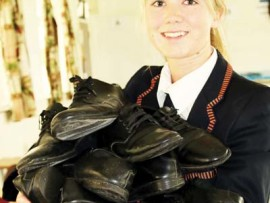 Emma George with the donated school shoes.