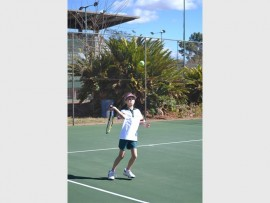 Kausta de Beer (Oosskool) hits the ball during a friendly game against Mitchell House played at the Polokwane Tennis Club's courts last Monday afternoon.