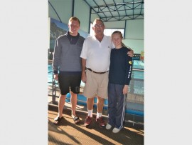 Ude Fuchs and Sulé van der Merwe with their coach Douggie Eagar after the SA Short Course Championship.