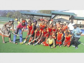 The proud hockey-team of Sunrise Primary School with their educators are very excited to participate in the finals in Durban during December. Photo: Supplied