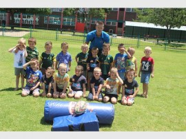 Jason Pretorius (Rugga Kids, Coach) with a few of the rugby in enthusiasts.