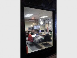 About 40 suspects threw bricks and stones through the SOS office windows on Tuesday night.