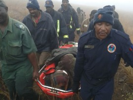 A 50-year old woman from from Matloulela village, Maake who was stranded on the mountains in Lekgalametse Nature Reserve since Sunday 24 July was rescued on Tuesday morning. Photos: Limpopo police