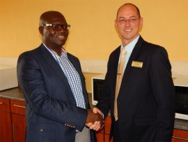 Department of Education MEC, Ishmael Kgetjepe, and Sun Meropa General Manager, Peter Guthrie.