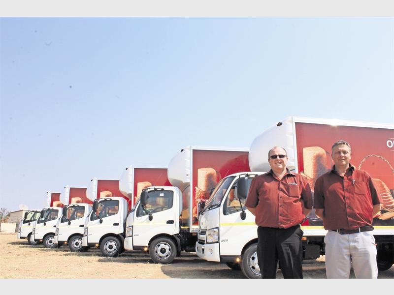 Proud moment for Hino Limpopo as Bergh van Rooyen (Hino Limpopo, Sales Manager) and Hannes Swanepoel (Hino Limpopo, Sales Executive) sign a mammoth contract. They are here with six of the 43 Hino 300-series 815 LWB trucks before delivery to a highly satisfied client.