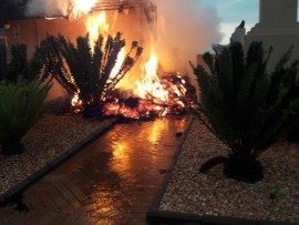 While many residents must add water damage to their list of expenses after yesterday's heavy rainfall wreaked havoc in the city, a man lost everything when lightning struck a grass lapa, causing a fire which spread to his home.
