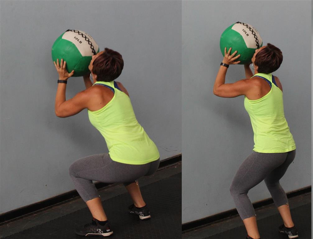 Personal trainer Liana Fourie shows how Wall Ball is done in her gym during a training session.