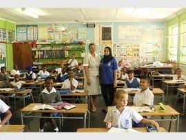 Foundation phase head, Ruth Julius invites Tasneem Moosajee into her Grade 2 class.