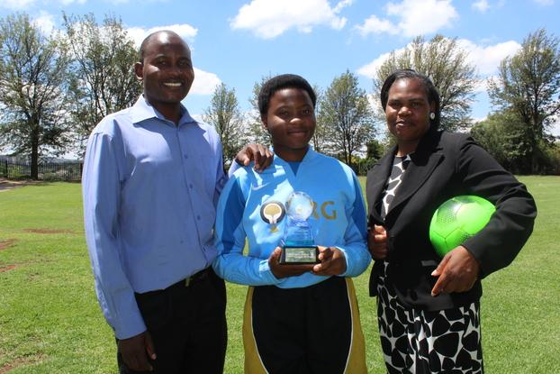 Emmanuel Mazivise, Elizabeth Mazivise and Mirriam Mazivise are proud sports fanatics.