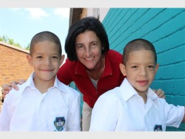 Izette Neethling with one of the two sets of twins, Marcelino and Valentino Marillier on their first day of school.