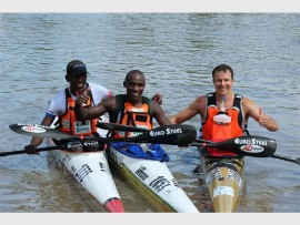 Canoeist Loveday Zondi, Siseko Ntondini and Alex Roberts are the top three finishers at the Vaal Parys Dusi style rive race. Photo: supplied.