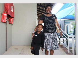 Andile stands proud with mother Alice Ncube.