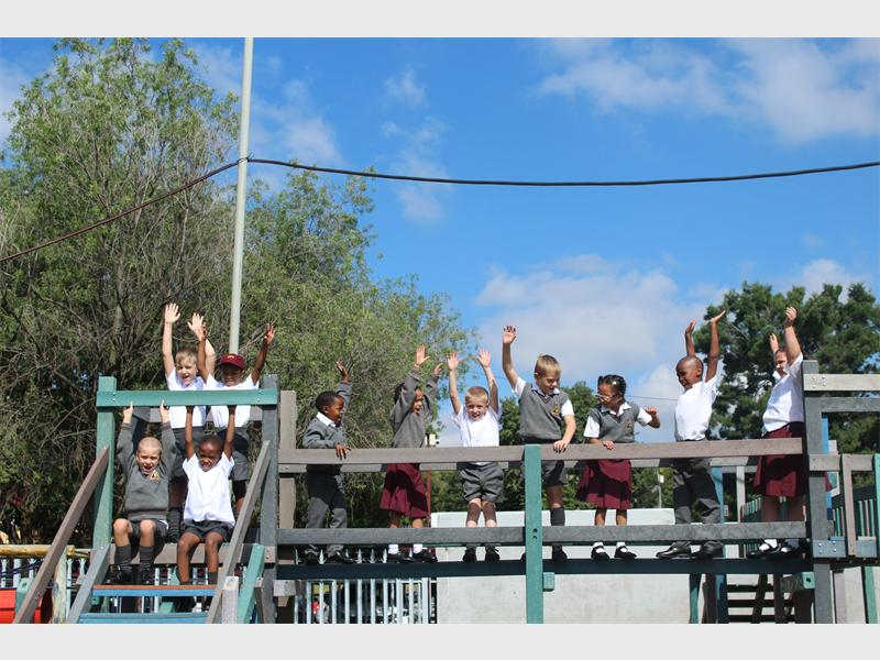 The Grade 1s of Delta Park School have some fun on the jungle gym.