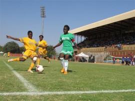 Brave Ladies' defender Risuna Macheke [yellow jersey] tries to clear the ball away from Vinolia Mabasa of Real Mighty Girls during mayor's tournament on Sunday at Giyani stadium.