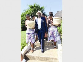 "Young girls in traditional Venda attire accompany chief Livhuwani ""Nkhiphitheni"" Matsila to the Tshima Awards launch."