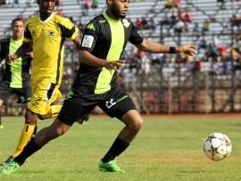 Milano United's striker, Ebrahim Seedat, puts pressure on Marks Munyai of Leopards during the first half of the match played at Thohoyandou Stadium on Saturday.