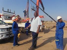 A service provider drills boreholes.