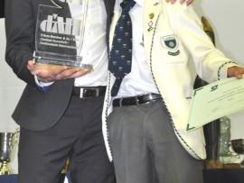 Rameez Tayob receives the D'Arcy Herrman Trophy from John McInroy.