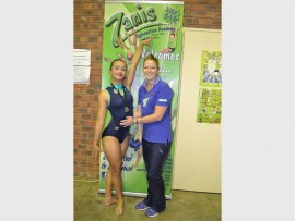 Leandré du Preez left her opponents far behind to  claim a gold medal during the Zone 5 Mini Trampoline Championships recently. With her is her coach, Tanya Bouwman.