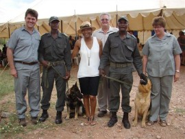 Photo: Supplied At the back is Conrad Strausse (Mapungubwe National Park, Park Manager) with Louis Lemmer, Charlet and Susan Otte from the Honorary Rangers together with David Malatji and Dumisani Mahumane (Mapungubwe National Park, Rangers) with the two sniffer dogs, Stacey and Mascot, that were donated by Woolworths over the weekend.