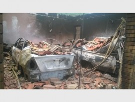 Lesenya's two vehicles are destroyed in the fire after a mob torched his property.