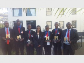The debate team made up of learners from S.J. van der Merwe Technical High School and Dendron Secondary School shows off some of their trophies.