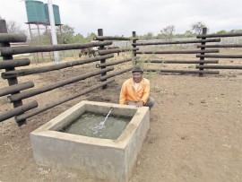 Mafemani Sithole pose next where the animals drink.